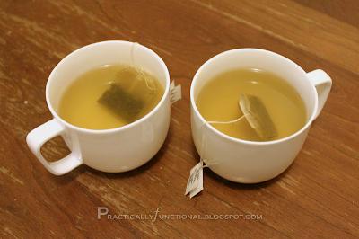 Two mugs of green tea
