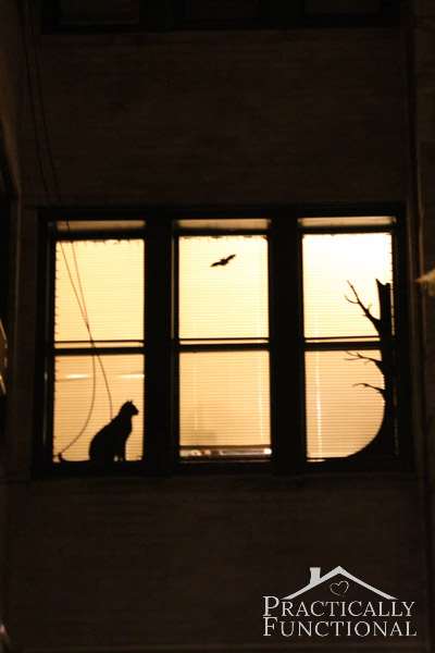Halloween Window Decor: Decorate a window with black vinyl and orange string lights!