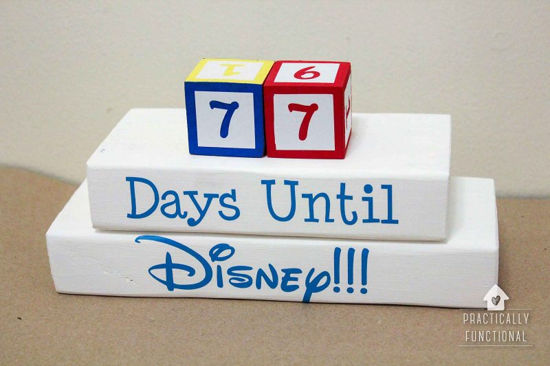 DIY disney countdown clock made with wooden cubes, short wooden 2x4 boards, craft paint, and adhesive vinyl