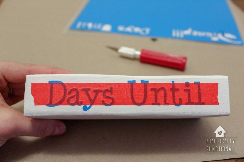 """""""days until"""" adhesive vinyl on painted wood block, transferred using washi tape"""
