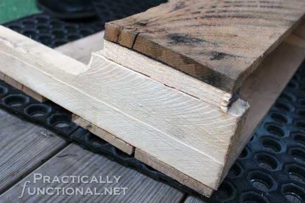 DIY Rustic Pallet Shelf Tutorial from PracticallyFunctional.net | Shelf widened by wooden spacers