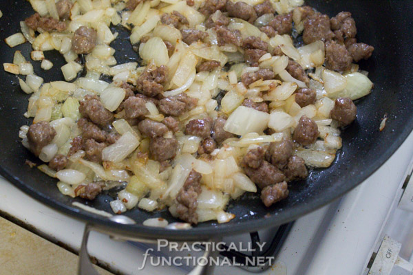 Meat Lover's Cheesy Potato Breakfast Casserole - Saute onions and sausage
