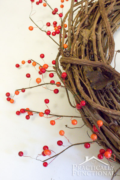 DIY Fall Monogram Wreath: Separate berry strands so they are evenly spaced, then flatten back down
