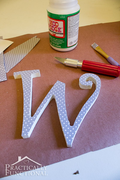 DIY Fall Monogram Wreath: Mod Podge paper onto a wooden monogram