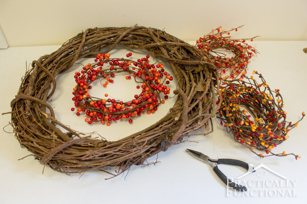DIY Fall Monogram Wreath from grapevine wreath form and berry garlands