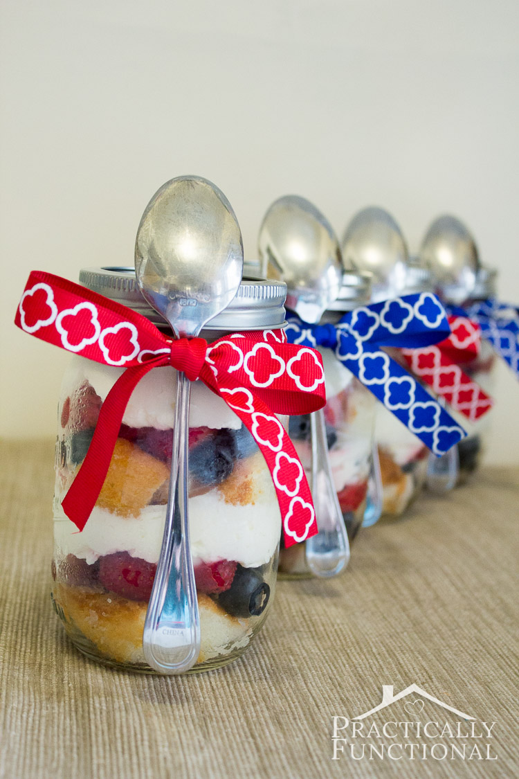 Fourth Of July picnic dessert: Strawberry blueberry trifle! Serve trifle in mason jars to get easy individual servings. Just tie a spoon to the jar with a ribbon, and serve!