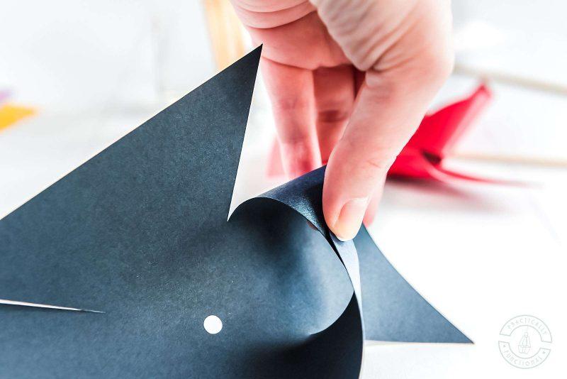 Fold paper pinwheel template to make pinwheels