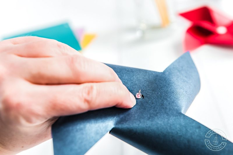 Use a small bead as a spacer when making paper pinwheels