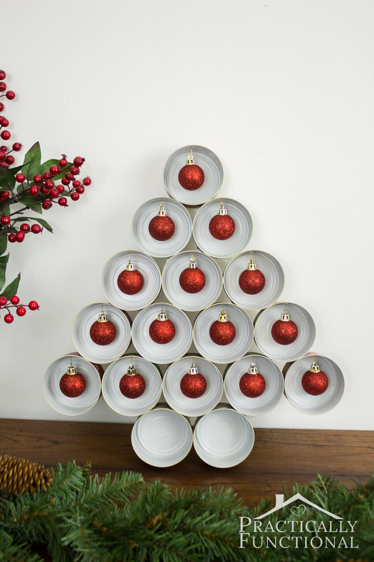 Recycle empty tin cans into a cute Christmas tree! Great way to recycle tuna cans or cat food cans!