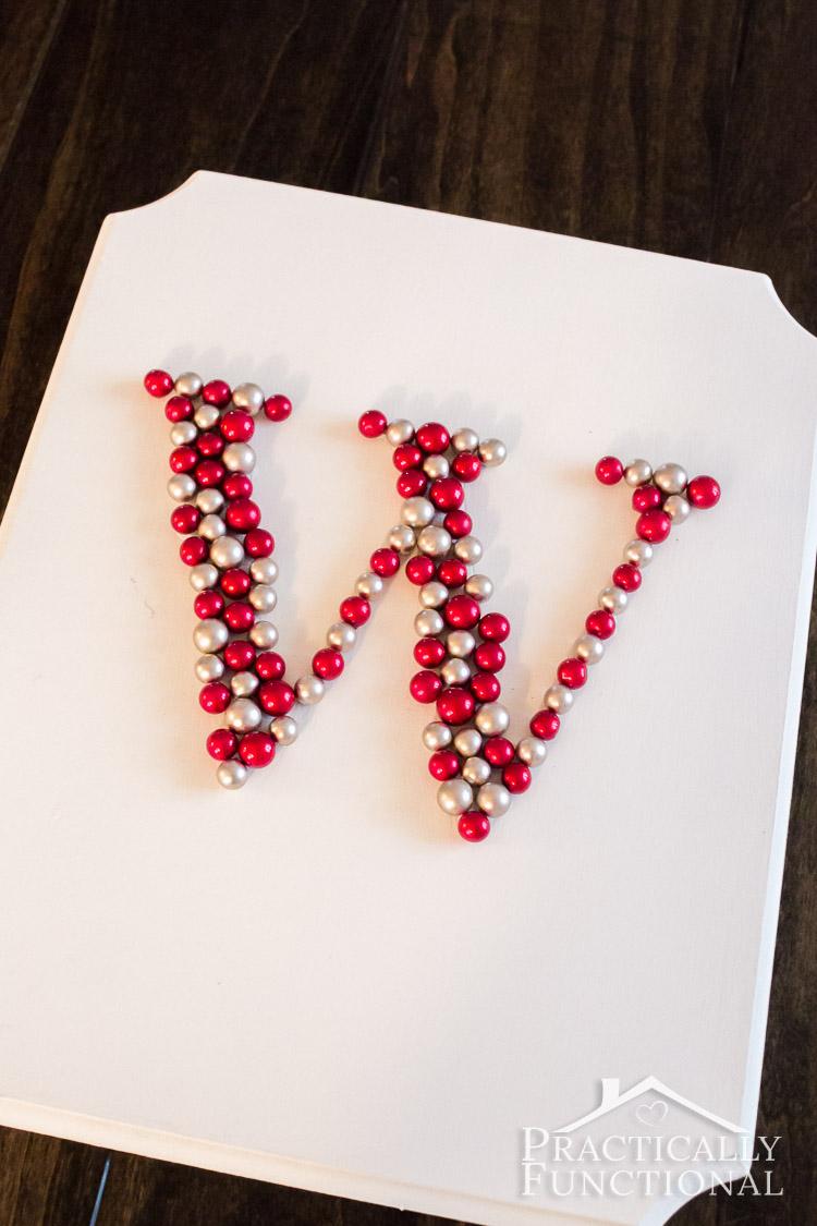 Turn winter berries into a monogram! Fun wreath alternative for the front door!