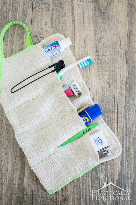 diy roll up toiletry bag made from a washcloth—laid open with toiletries and travel items in the pockets