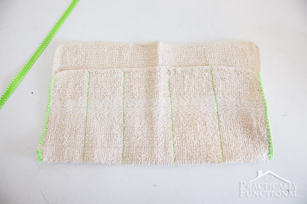 washcloth folded in half with lines sewn vertically to create small pockets