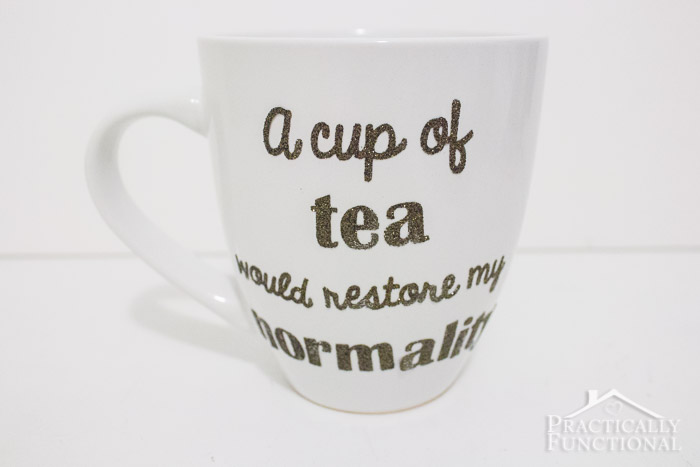 plain white ceramic mug decorated with heat transfer vinyl saying a cup of tea would restore my normality
