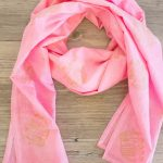 Make your own lightweight pink and gold elephant scarf with Rit dye, fabric ink, and stamps!
