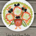Make a cute turkey fruit and veggie platter; perfect for Thanksgiving!