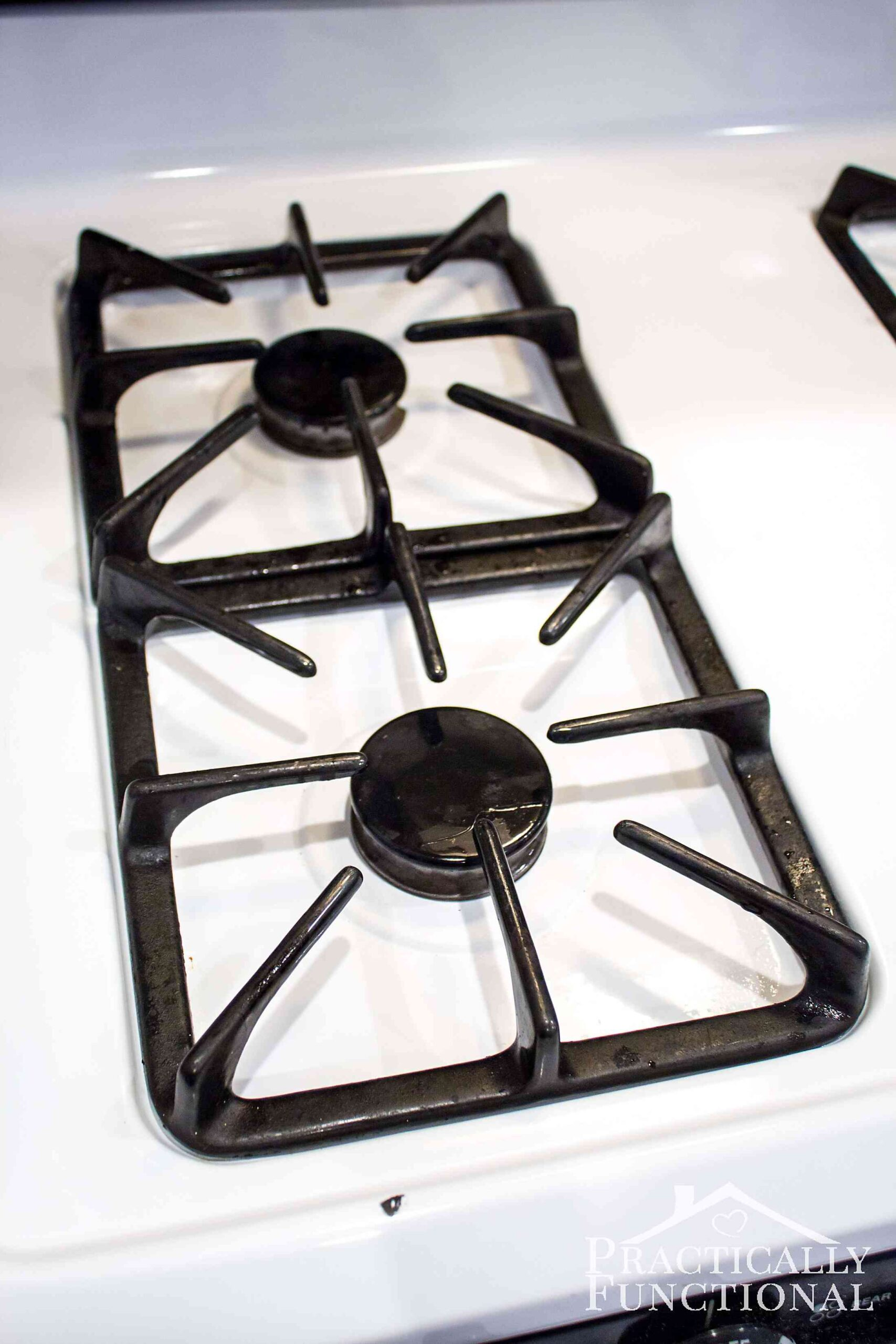 How To Really Clean A Stove Top Even All The Baked On Gunk Practically Functional