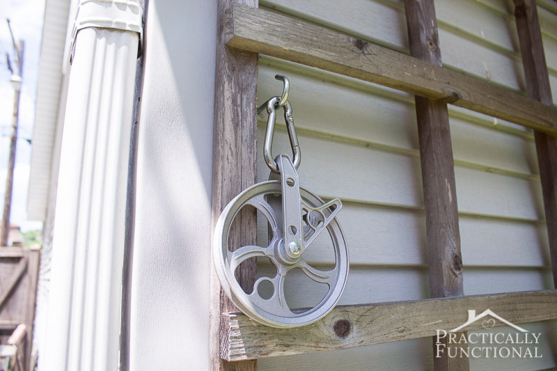 Attach a pulley to a wall with a screw hook and carabiner to make a DIY pulley clothesline