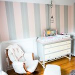 AJ's DIY steampunk nursery is still a work-in-progress, but today I'm sharing how we painted the walls in three sets of pink and grey stripes!