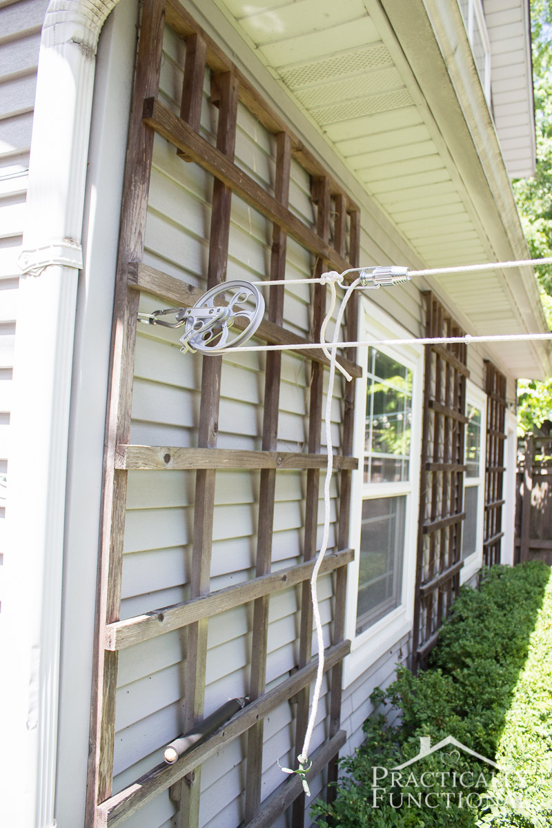 DIY pulley clothesline with a line tightener to keep the line from sagging
