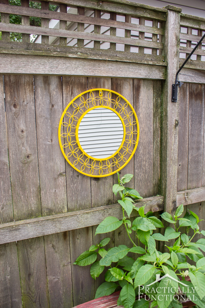 Brighten up your yard with a fun mirror on the fence!