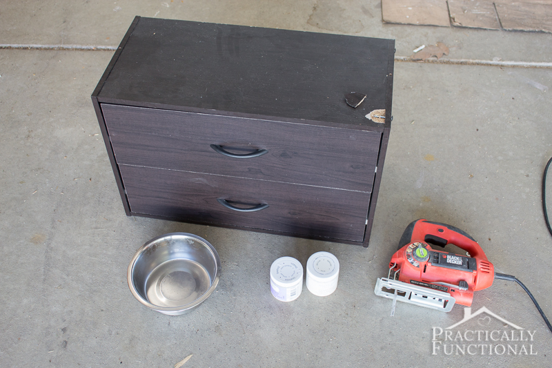 All you need to create a DIY raised dog bowl stand is a small dresser, a jigsaw, dog bowls, and paint!