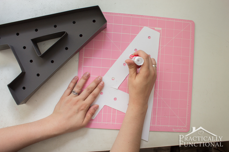 DIY marquee letter - glued scrapbook paper into painted marquee letter