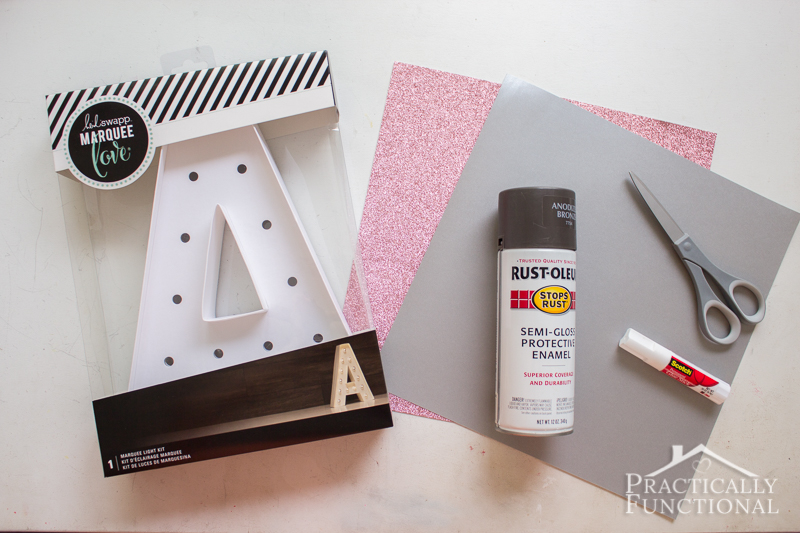 DIY marquee letter using a Heidi Swapp marquee letter, spray paint, and scrapbook paper