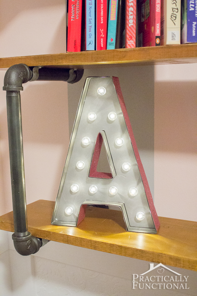 This cute DIY marquee letter is so easy to make! Start with a Heidi Swapp marquee letter, and just add spray paint and scrapbook paper!