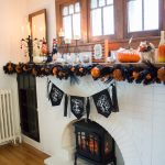 Create a fun and festive Halloween mantel in just a few minutes with a few simple decor pieces!