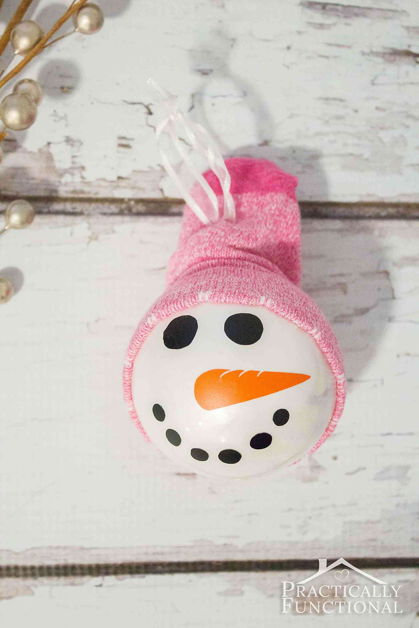 Got a sock that's missing it's pair? Make a cute DIY snowman ornament with it!