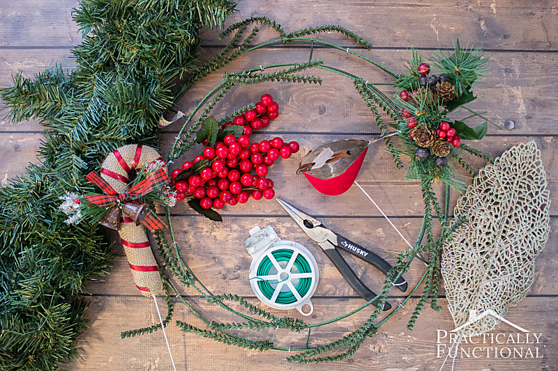 Supplies needed to make a DIY winter greenery wreath