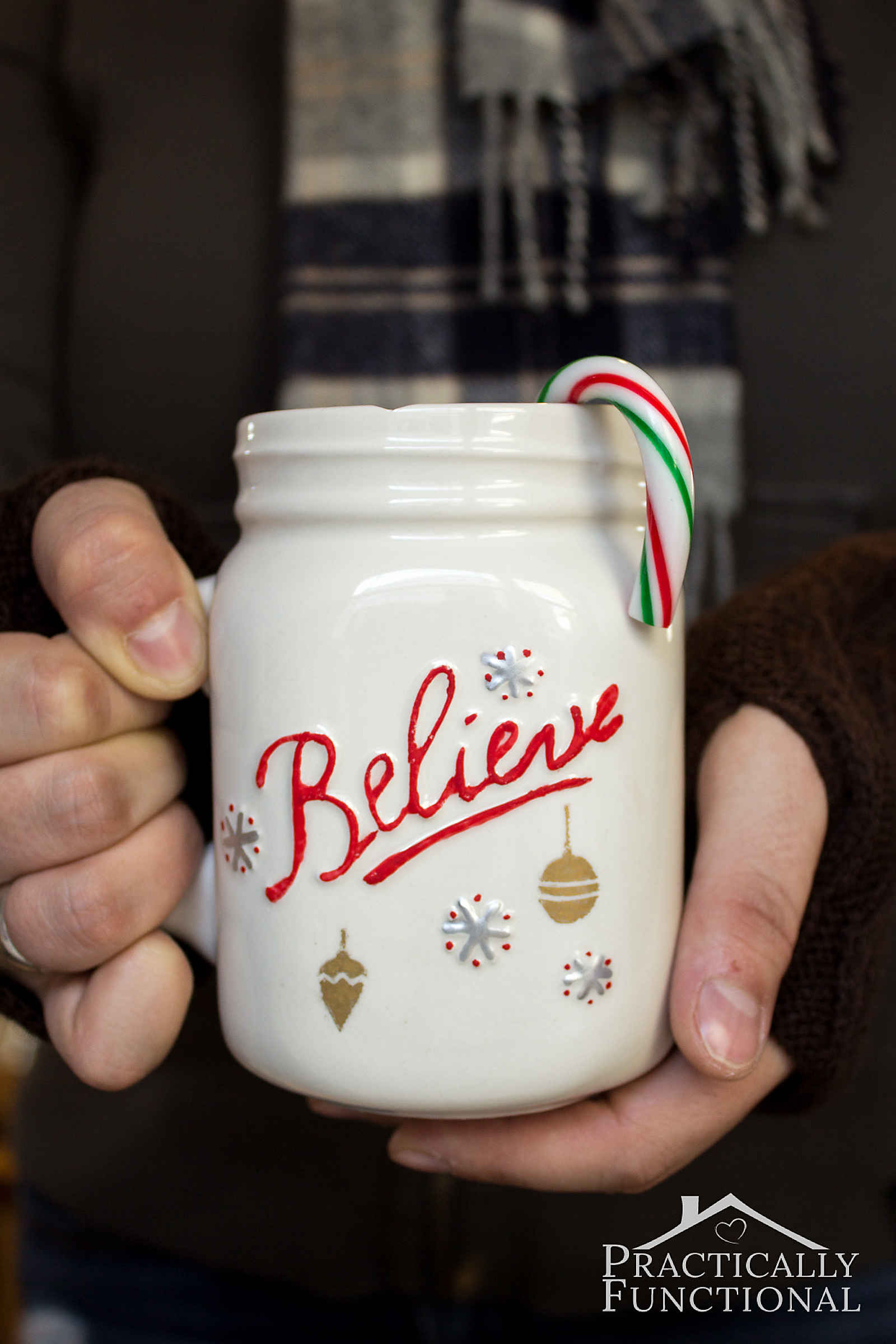 Make a cute DIY painted mug for the holidays with paint pens and adhesive stencils! Great neighbor gifts!