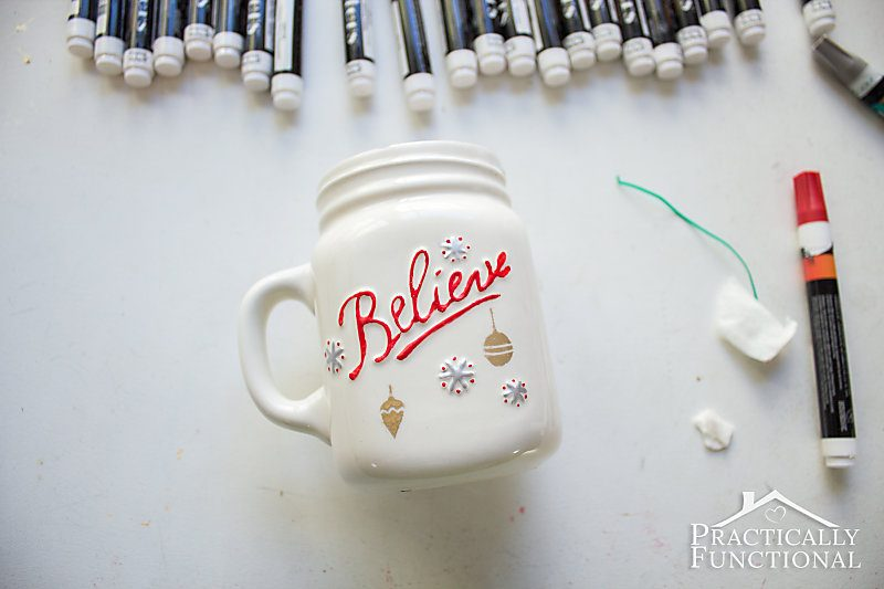 painters opaque paint markers above painted white ceramic mug