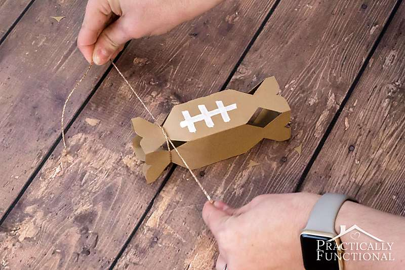 Make your own football-shaped treat boxes with these free printable templates! Just cut, glue, and fill with treats; perfect for a football party!