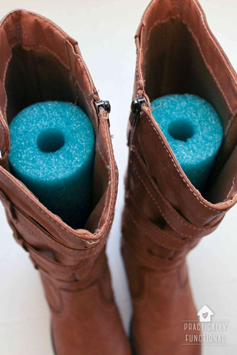 Use a pool noodle to keep your boots standing up