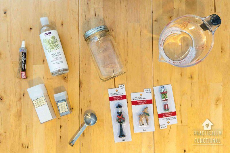 mason jar, glycerine, glitters, and miniature figurines—supplies for making a homemade snow globe