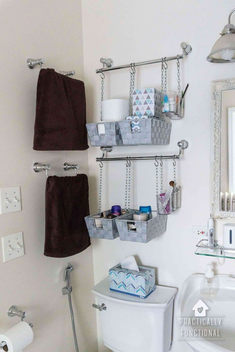 hanging storage bins over the toilet