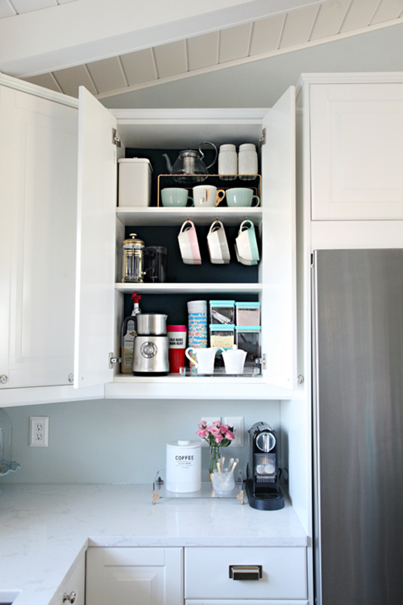 Organize your coffee cabinet with hooks