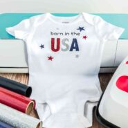born in the usa baby onesie with cricut maker, cricut easypress, and rolls of heat transfer vinyl