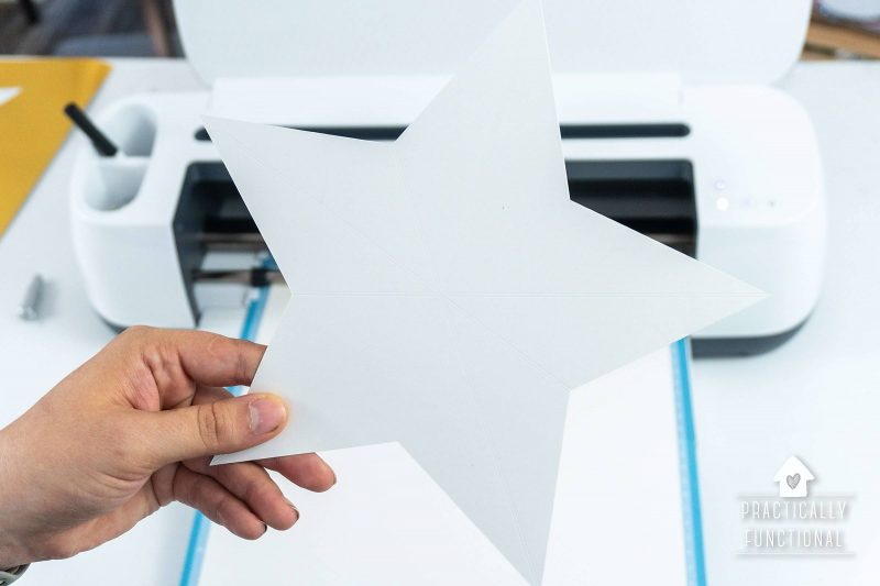 3d paper star scored and cut out by the cricut maker