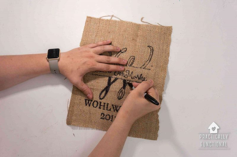 Fill in monogram design with black marker on burlap