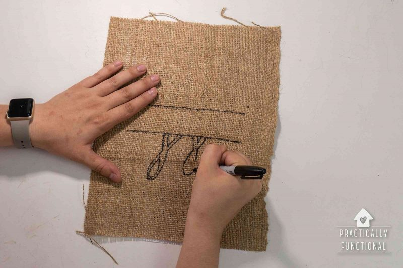 Trace printed monogram design on burlap