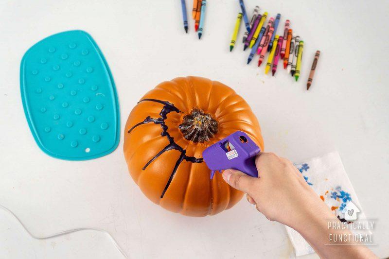 Melt crayons onto pumpkin using hot glue gun
