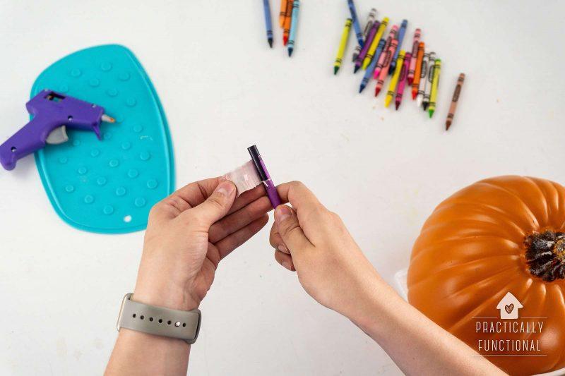 Peel crayon paper before using in hot glue gun