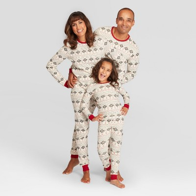 Burts bees baby holiday snowflake family pajamas and 19 other matching family Christmas pajamas that are warm, comfy, and totally budget-friendly!