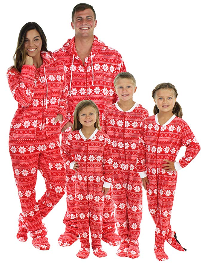 Family matching red snowflake footed pajamas and 19 other matching family Christmas pajamas that are warm, comfy, and totally budget-friendly!