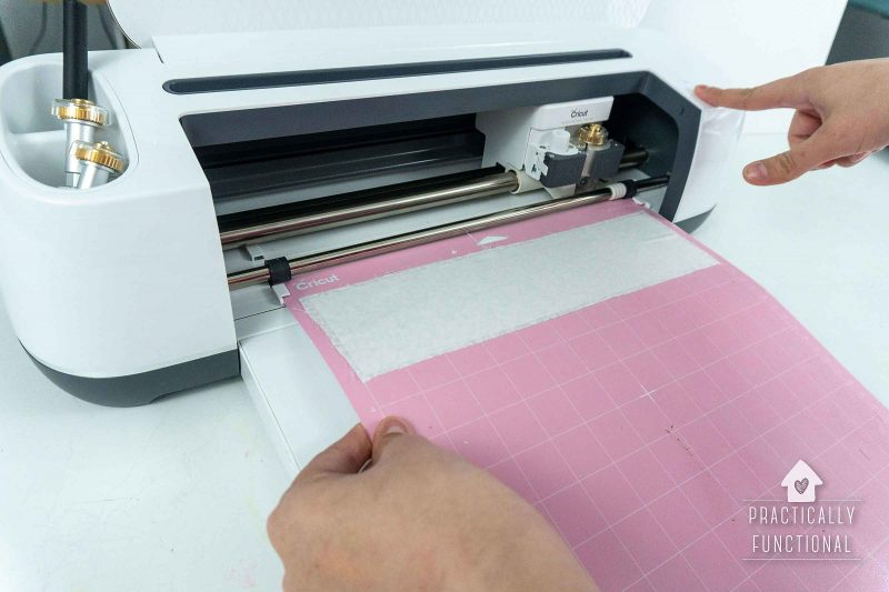 Use a rotary blade in a cricut maker to cut fabric and interfacing for matching family christmas pajamas