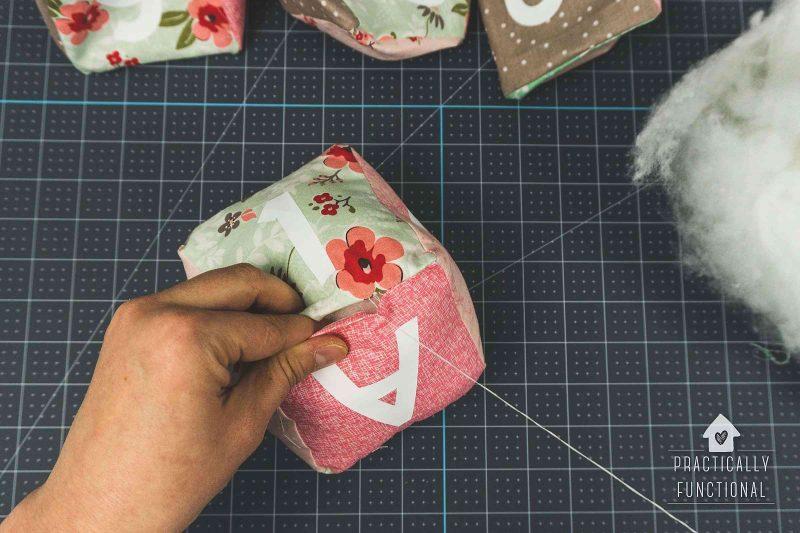 Sew soft baby blocks closed with a ladder stitch