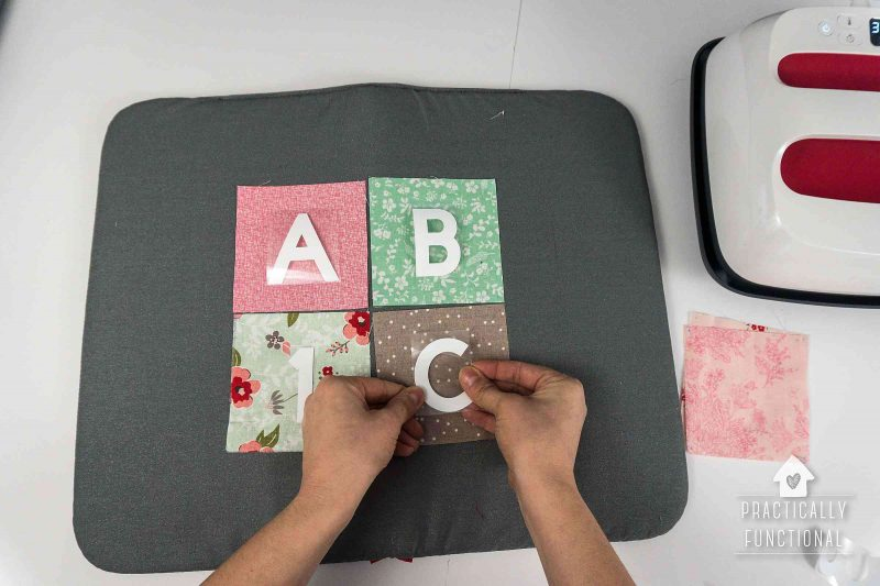 Use a cricut easypress 2 to stick letters and numbers on your soft baby blocks