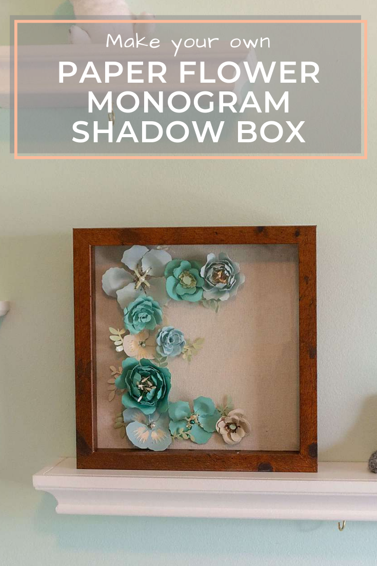 This simple paper flower monogram inside a shadow box is a great wedding or baby shower gift! All you need is cardstock, glue, a shadow box, and a Cricut!